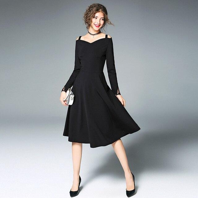 zwarte jurk met lange mouwen