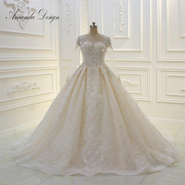 فستان زفاف عالي الجودة بأكمام طويلة مزين باللؤلؤ الشامبانيا بتصميم أماندا