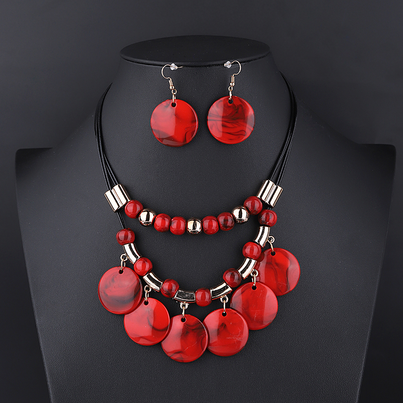 Multiple-strand-circular-swirled-discs-necklace-and-earring-set