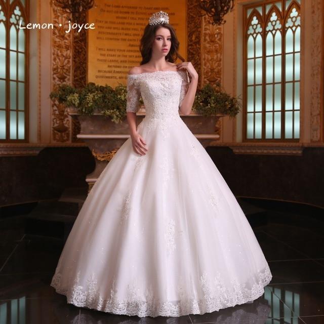 ad3c1303309 Luxe dentelle robes de mariée 2019 élégant avec col bateau perles demi  manches robes de bal