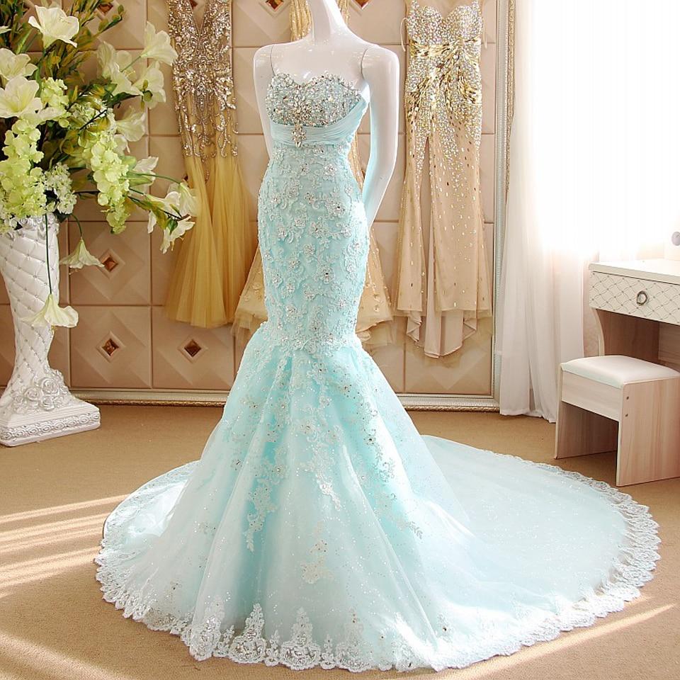 royalty free stock photo little bride girl lush white blue wedding dress image blue wedding dresses A girl in a lush white and blue wedding dress