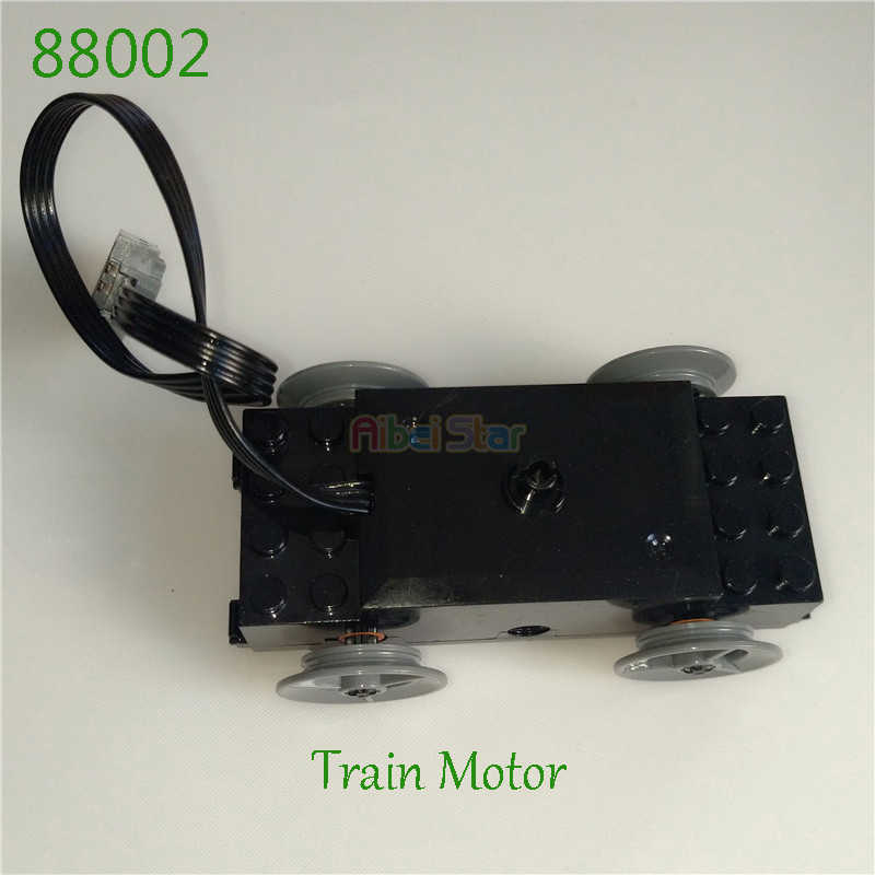 Aibei Star- Technic compatible Series Parts: Train Drive Motor 88002 with four Wheels and two Axles.