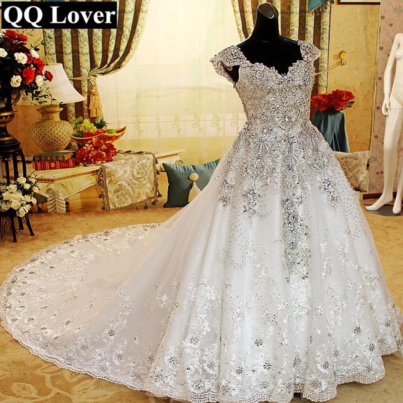 QQ Lover 2019 New Arrival Top Crystals Beaded Cap Sleeves Big Train Lace Wedding Dress Bridal Gown Vestido De Noiva