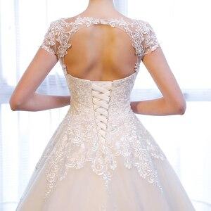 Image 5 - SL 307 Charming A linie Kurzarm brautkleider Spitze Appliques Strand Vintage SuLi Hochzeit Kleid frau hochzeit kleider für braut