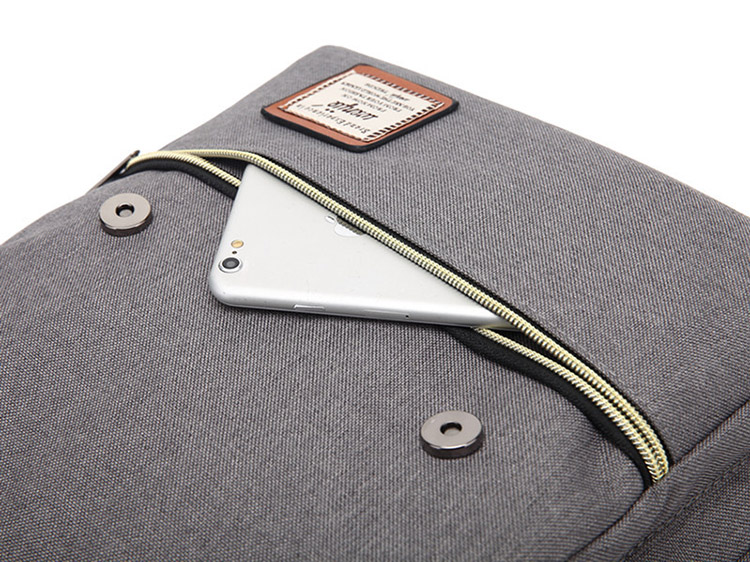 a photo of a tablet inside a grey backpack