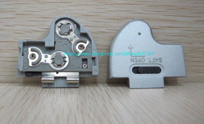 90%NEW original <font><b>gray</b></font> door cover for <font><b>canon</b></font> A610 battery cover camera repair parts free shipping