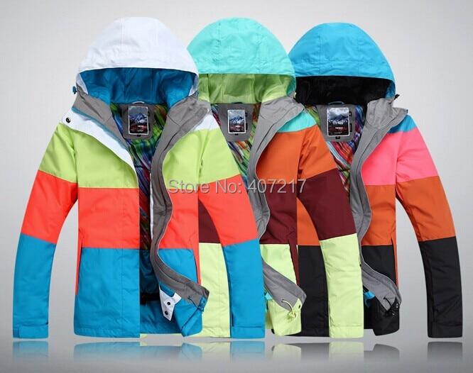 Prix pour 2014 nouveau femmes ski veste couleur correspondant snowboard veste dames étanche respirant neige parka vêtements de ski anorak 3 couleurs XS-L