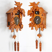 American cuckoo clock cuckoo clock fashion pastoral music photosensitive newspaper clock bird solid wood carved clocks LM6011611
