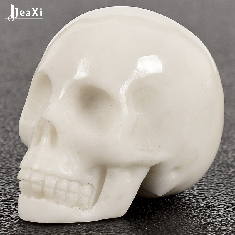 Natural crystal stone skull statue mineral quartz 2 inch white jade Skull figurine Hand carved bone feng shui healing collectionNatural crystal stone skull statue mineral quartz 2 inch white jade Skull figurine Hand carved bone feng shui healing collection