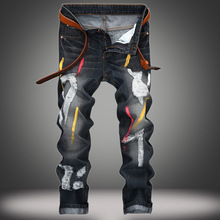 Youth popular fashion personality paint splash mens jeans Europe and hole straight type brand trousers men