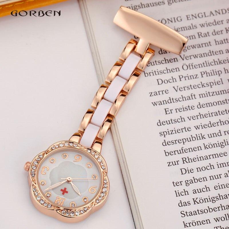 5b9bf91fa4d New Fashon Mostrador do Relógio Da Enfermeira para As Mulheres Broche de  Flor de Cristal Elegante Clip on Relógio de Aço Completa Analógico Quartzo  relógio ...