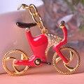 Diseño creativo de la bicicleta llaveros anillos ornamentos del coche del arte del esmalte de oro de polonia Llavero Mujer Chaveiro del Personalizado Chaves
