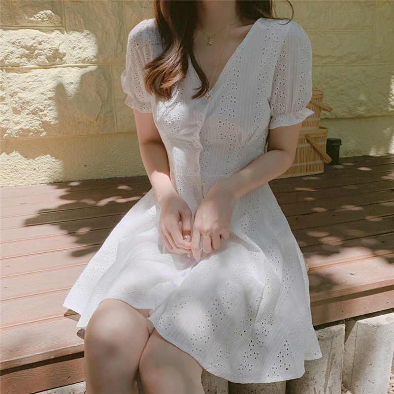 Vestido de algodón ahuecado con botones blancos cuello en v acampanado corto coreano Harajuku vestidos de verano 2019 girasol Ropa Femenina Kadın