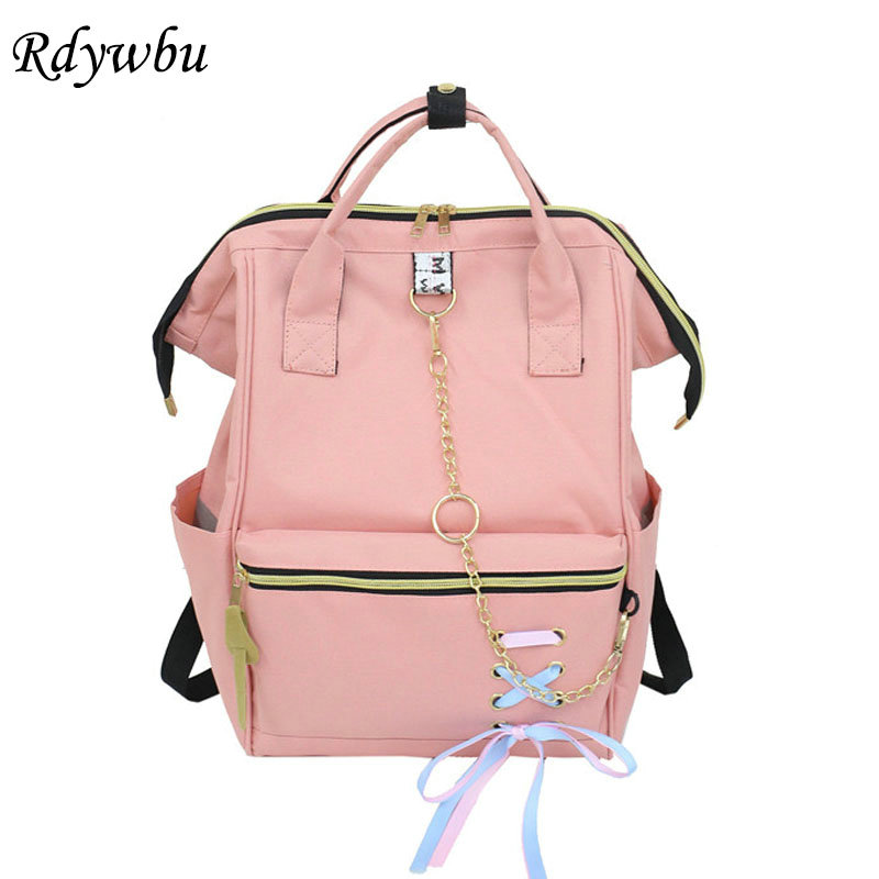 купить Rdywbu Metal Ring Chain Backpack With Ribbons Teenagers Big Capacity Schoolbag School Book Bag Girl Travel Bag Mochila B596 по цене 1219.2 рублей