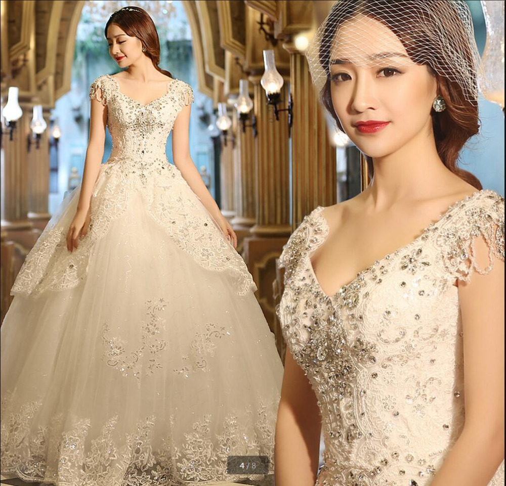New Arrival Ball Gown Cap Sleeve Heavily Beading Wedding Dress V Neck Princess Puffy Bridal Gowns Appliques Lace Bride Dress