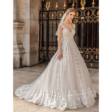 Eightree Free Bridal Veil Wedding Dresses Appliques Luxury Cap Sleeve V neck Bride Gowns Chapel Train Illusion Backless 2019