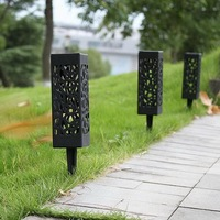 Outdoor waterproof solar lamp hollow creative warm LED light sensor control lawn garden lamp