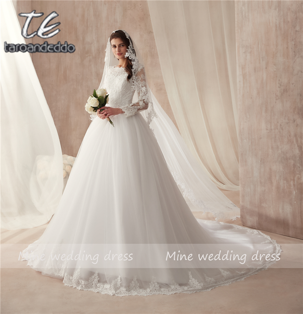 Sheer High Neck Long Sleeve White Tulle Ball Gowns Wedding Dress with Crystals Bandage Lace Up