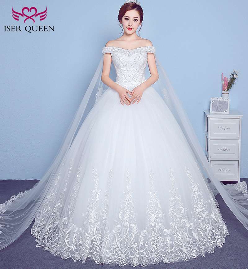 Fashion Cap Sleeve With Wrap Embroidery Lace Wedding Dress 2018 Pearls  Beads Ball Gown Plus Size Arab Wedding Dresses WX0018-in Wedding Dresses  from ... b83d02578560