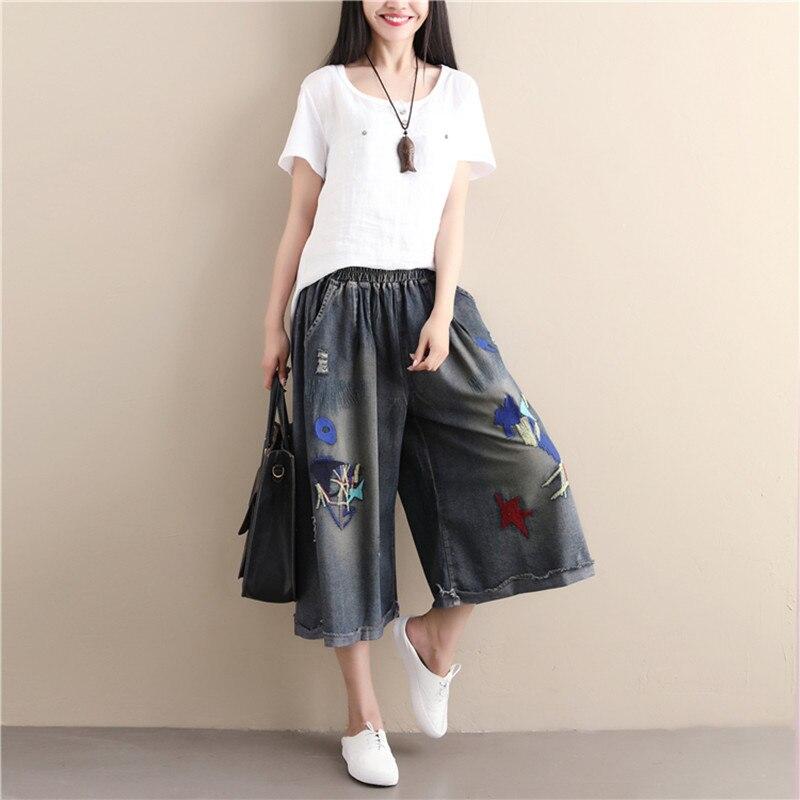 Qiukichonson ripped jeans plus size fatter women embroidery 2018 fashion applique wide leg pants elastic waist denim capri pants