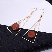 The triangle  Round design feels modern temperament long geometry character of circular wood earrings stud
