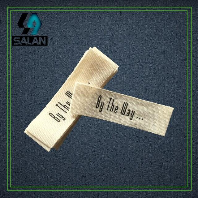 Etichette di abbigliamento su misura in cotone stampato Cotone Etichetta di  Cucito Tessuto di cotone stampato 471b2bf3e44