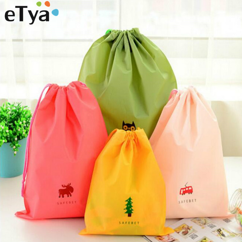 eTya Women Cartoon Drawstring Pouch Travel Clear Bags Clothes Storage Luggage Bags Waterproof Clothing Bag Travel Accessories все цены