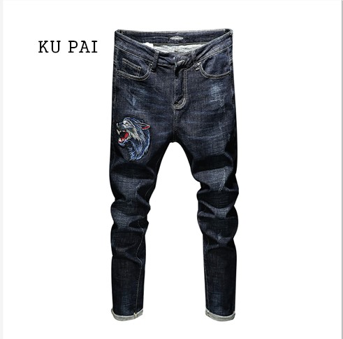 2017 winter velvet trousers with slim feet stretch jeans pants young male trend of Korean embroidery pattern animal pants