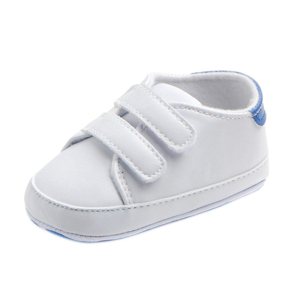 Для младенцев, одежда для малышей, для мальчиков и девочек мягкая подошва кроватки, белые и черные кроссовки со шнурками для новорожденных и...