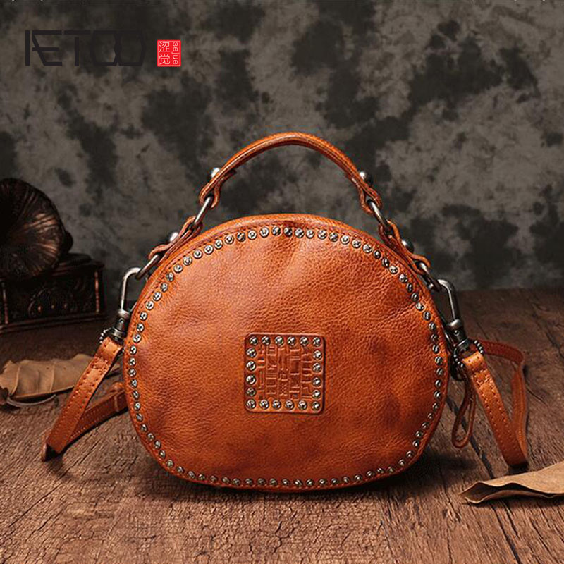 AETOO The first layer of leather handbags new leather rivet pouch retro bills shoulder slung small round bag femaleAETOO The first layer of leather handbags new leather rivet pouch retro bills shoulder slung small round bag female