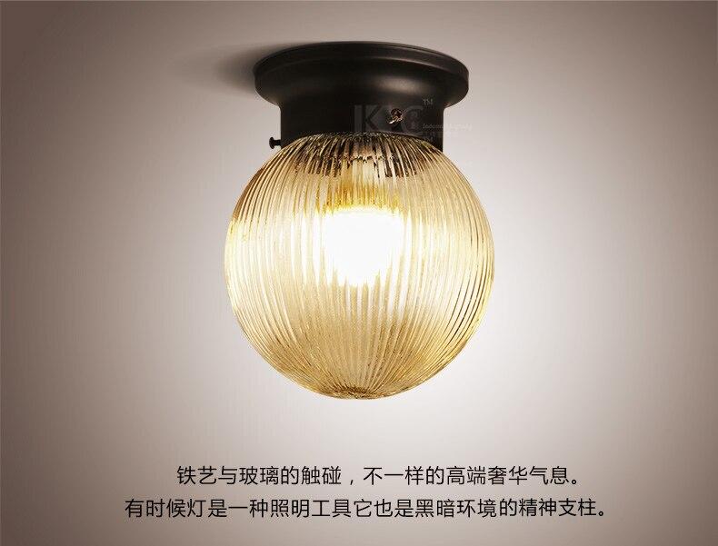 Paese stile della sfera di vetro lampada da parete contratta