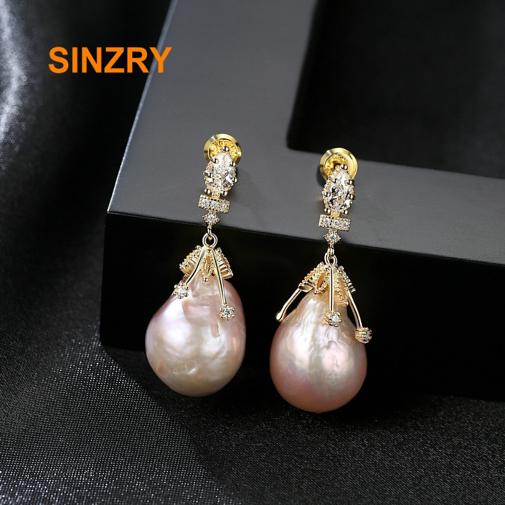 цена на Sinzry Brand Baroque Oval Shape Natural Freshwater Pearls drop Earrings 925 sterling Silver elegant Fine Jewelry