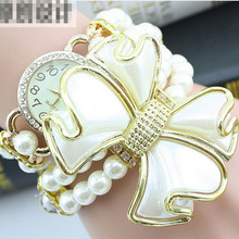 Hot sale luxury with resin white pearl bracelet flower pendant quartz watch women dress watch montre 2017 female feminine clock