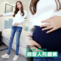 Make autumn wear maternity clothes new holes embroidered skinny jeans abdomen pants fall pregnant women pants