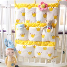 50*60cm Hot Crown Baby Bed Hanging Storage Bag Toys Diaper Pockets for Crib Bedding Set Baby Cot Crib Organizer Bed Bumper(China)