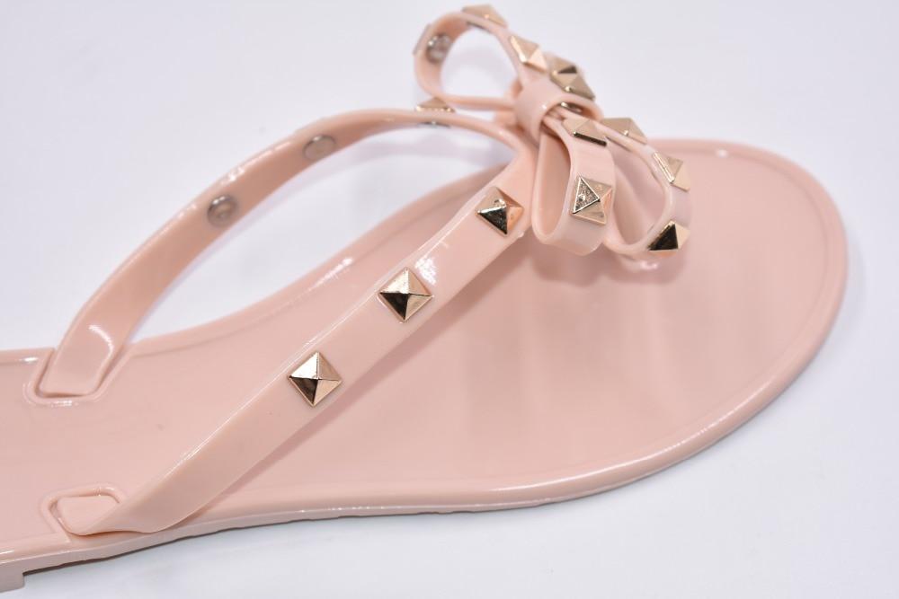 HTB1Vr6ErCtYBeNjSspaq6yOOFXai Hot 2017 Fashion Woman Flip Flops Summer Shoes Cool Beach Rivets big bow flat sandals Brand jelly shoes sandals girls size 36-40