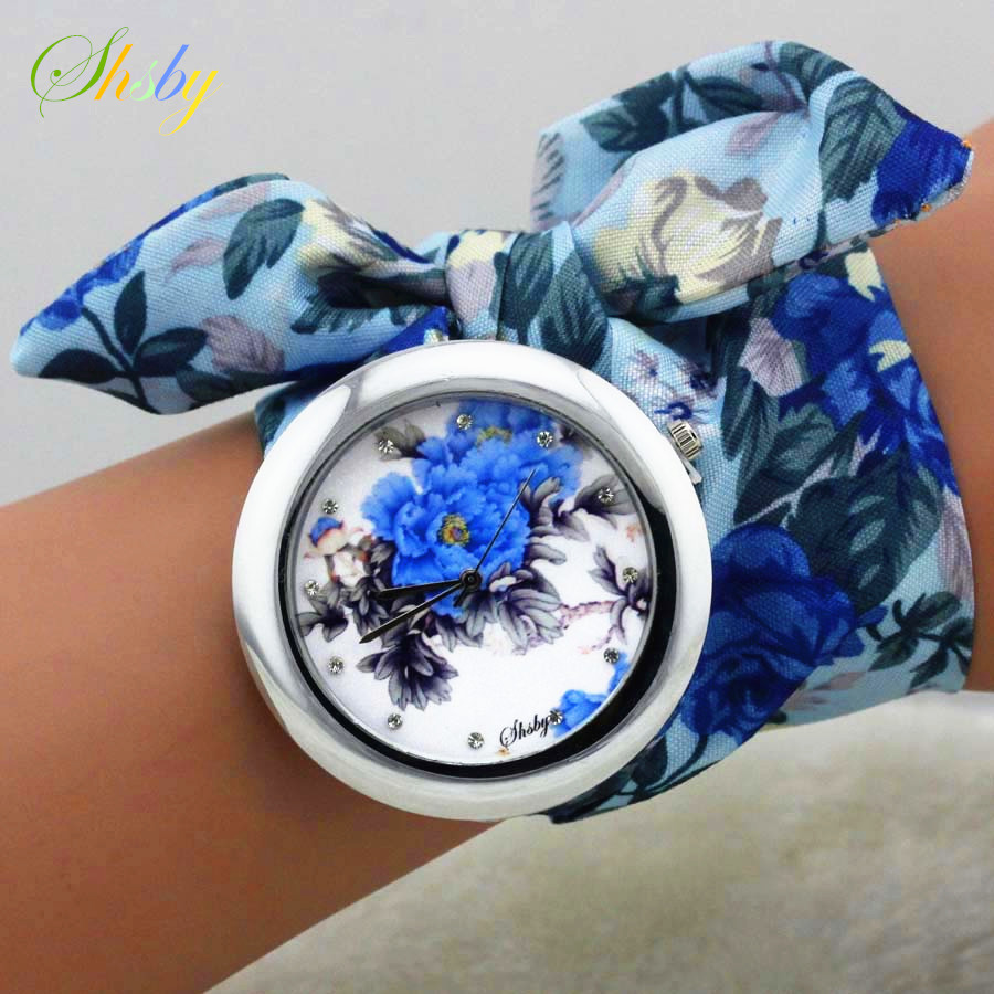 shsby 2018 नई डिजाइन देवियों फूल कपड़े कलाई घड़ी फैशन महिलाओं की पोशाक घड़ी उच्च गुणवत्ता वाले कपड़े घड़ी प्यारी लड़कियों घड़ी