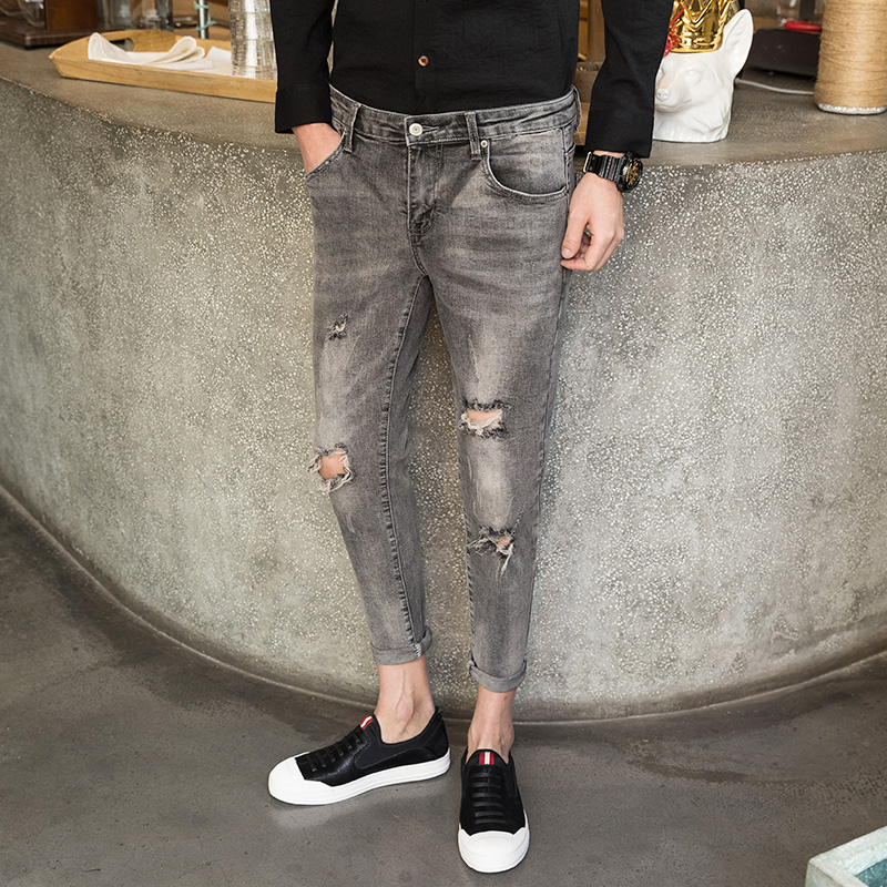 2019 spring new hole jeans male Korean version of the tide casual wild stretch Slim feet nine points jeans men