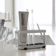 Toothbrush Holder Wall Mounted Toothpaste Dispenser Bathroom Stand Suction Rack New