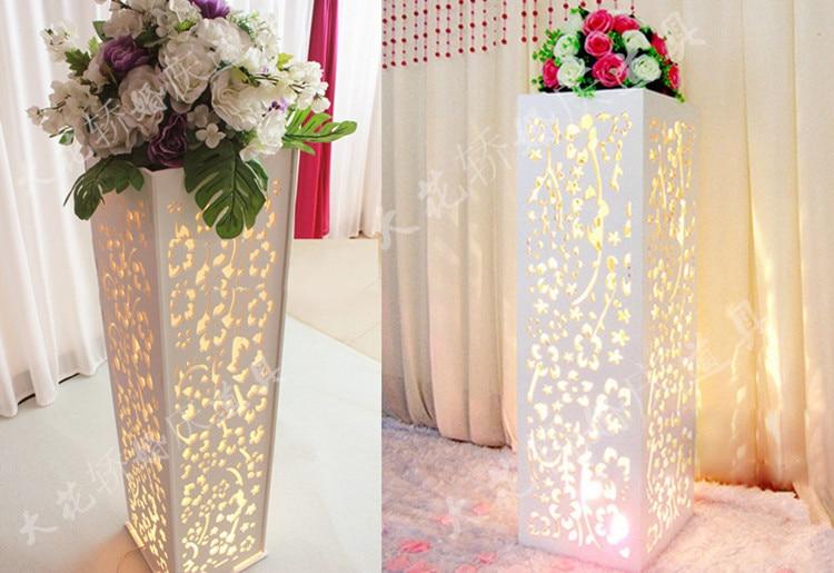 Wedding arrangement carved pillar road lead wedding stand