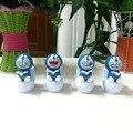Precio al por mayor 120 unidades Por Lote Asintiendo A Plena Luz Cuatro Caras Diferentes Juguetes de La Novedad Baile Feliz Solar Doraemons