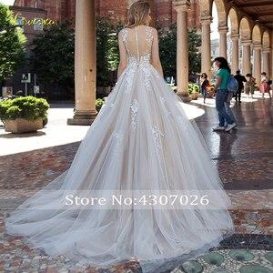 Image 2 - Loverxu colher uma linha vestido de casamento 2019 apliques ilusão tanque manga botão vestido de noiva chique tribunal trem vestido de noiva mais tamanho