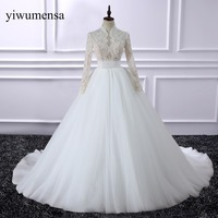 Robe De Mariee Long Sleeves Sexy Wedding Dresses Illusion Back Pearl Crystal Beaded Lace Bridal Gown