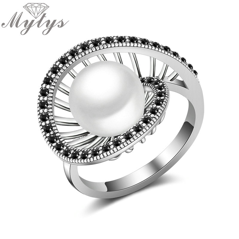 Mytys New Design Geometric Hollow Round Pearl Center Retro Black Marcasite Stone Invisible Setting Antique Pearl Ring R2021 pearl detail hollow panel dress