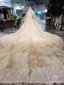 Image 2 - LS11555G Golden Trouwjurken Gown Met Bruiloft Sluier O hals Lange Mouw Bloemen Bridal Dress Met Trein فساتين طويله