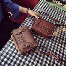 2017 new female leather bag retro small package season double belt mini diagonal cross package