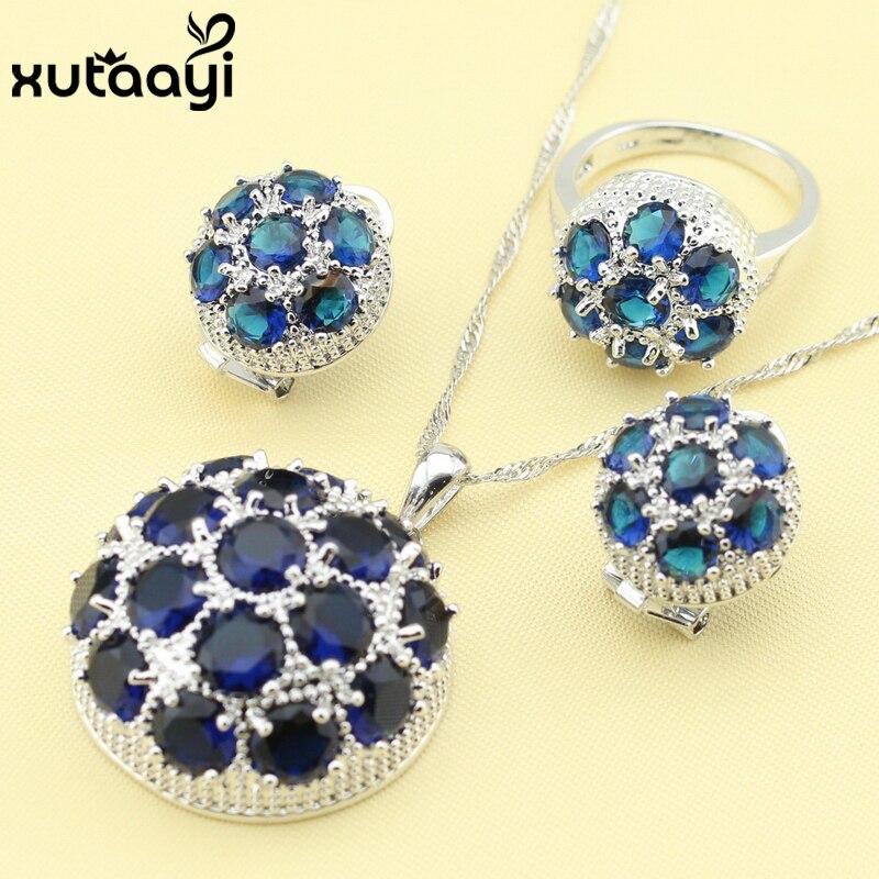 bfd42bed7048 Caliente-venta de Moda de Joyería de Plata 925 Establece Gran Circón Azul  Magnífico Collar Anillos Pendientes de Regalo de Navidad Para Las Mujeres