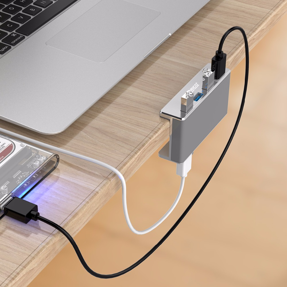 Купить с кэшбэком ORICO MH4PU Aluminum 4 Ports USB 3.0 Clip-type HUB For Desktop Laptop Clip Range 10-32mm With 150cm Date Cable - Silver