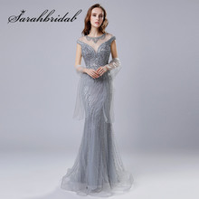 Elegant Sliver Evening Dresses 2018 New Sexy Illusion Neck Sheer Back Stunning Beaded Crystals Party Celebrity Gowns CC470