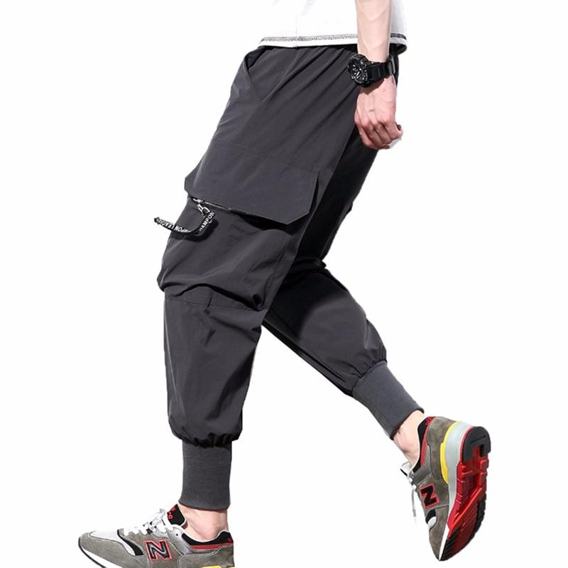 2018 Casual Hosen Männer Schwarz Cargo Hosen Bänder Hüfte Hop Taschen Jogger Jogginghose Mann Ankle-länge Harem Hosen Männlichen Hosen
